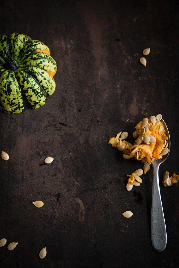 Sweet dumpling pumpkin with pulp and pumpkin seeds