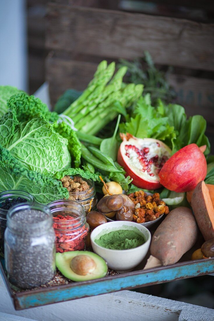 Vegetables, fruit, berries, seeds, and wheatgrass for superfood recipes