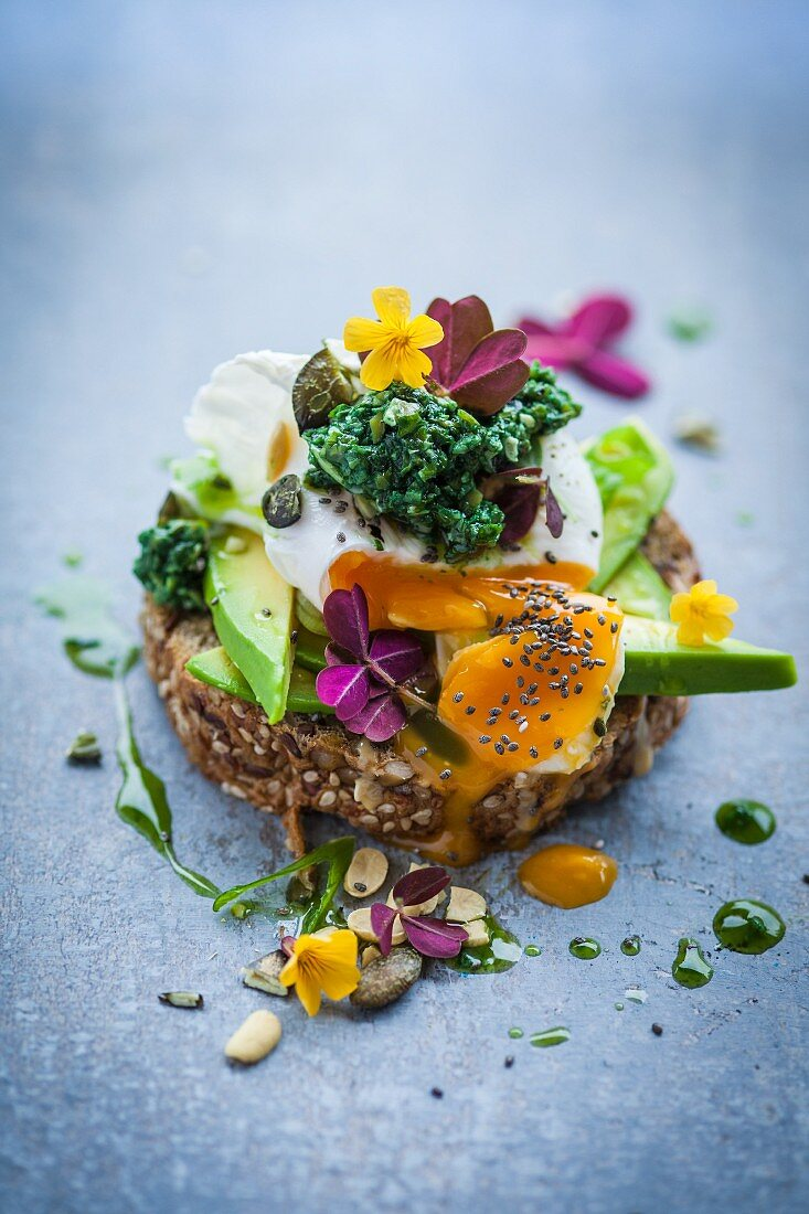 Bread topped with an avocado, egg and kale tapenade