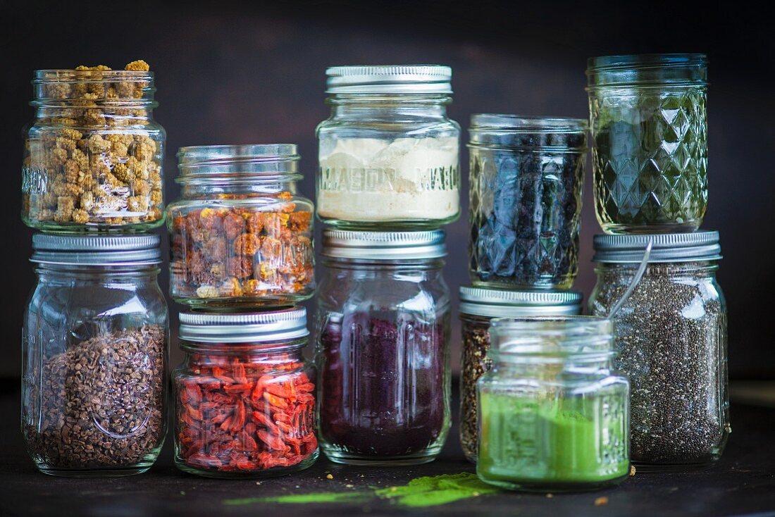 Various ingredients in screw top jars for superfood recipes