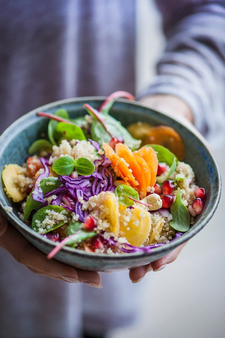 A Thai quinoa salad with red-veined dock, vegetables, pomegranate seeds, and peanuts (Superfood)