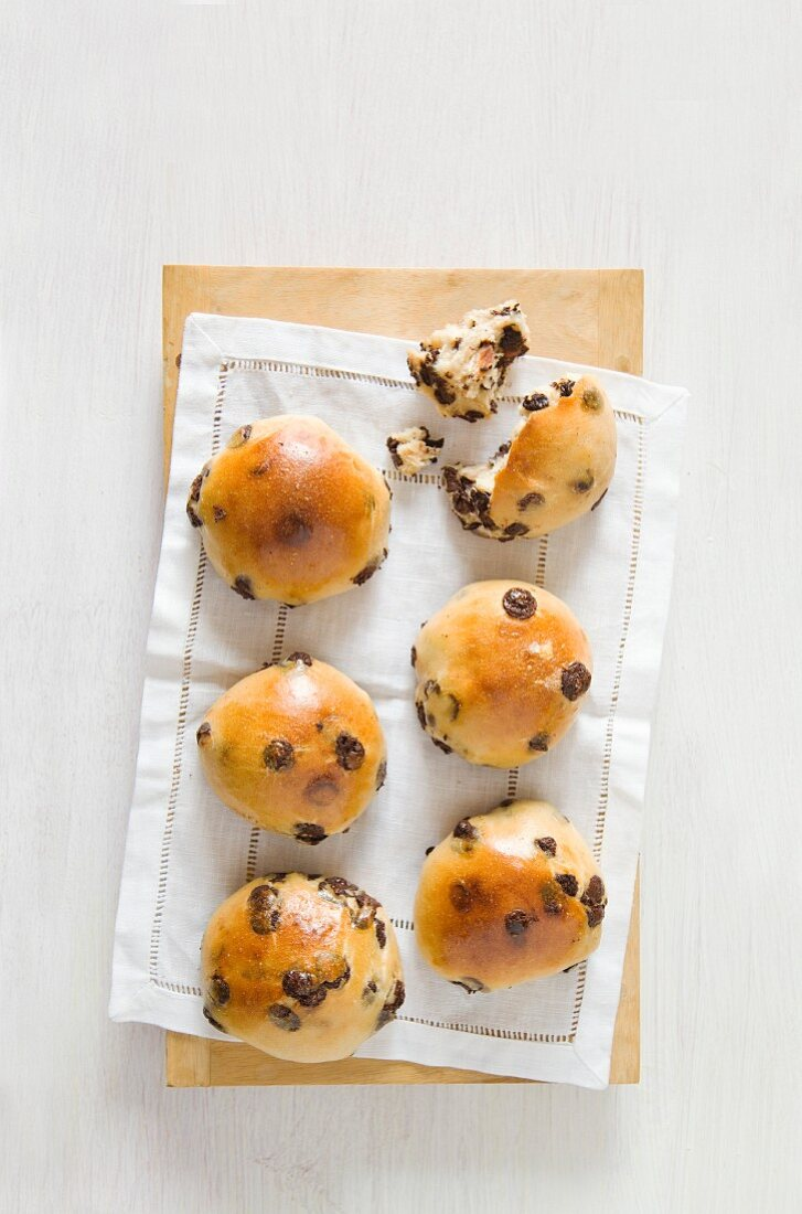Chocolate bread rolls on a linen cloth