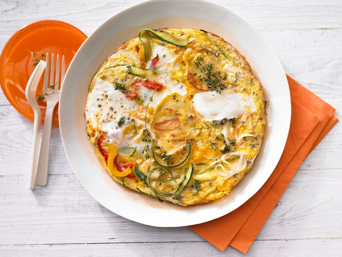 A potato tortilla with peppers and courgette