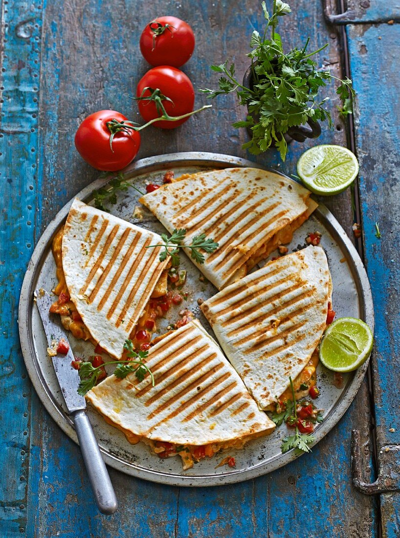 Mexican chicken tortillas with cheese, pepper and tomato & coriander salsa