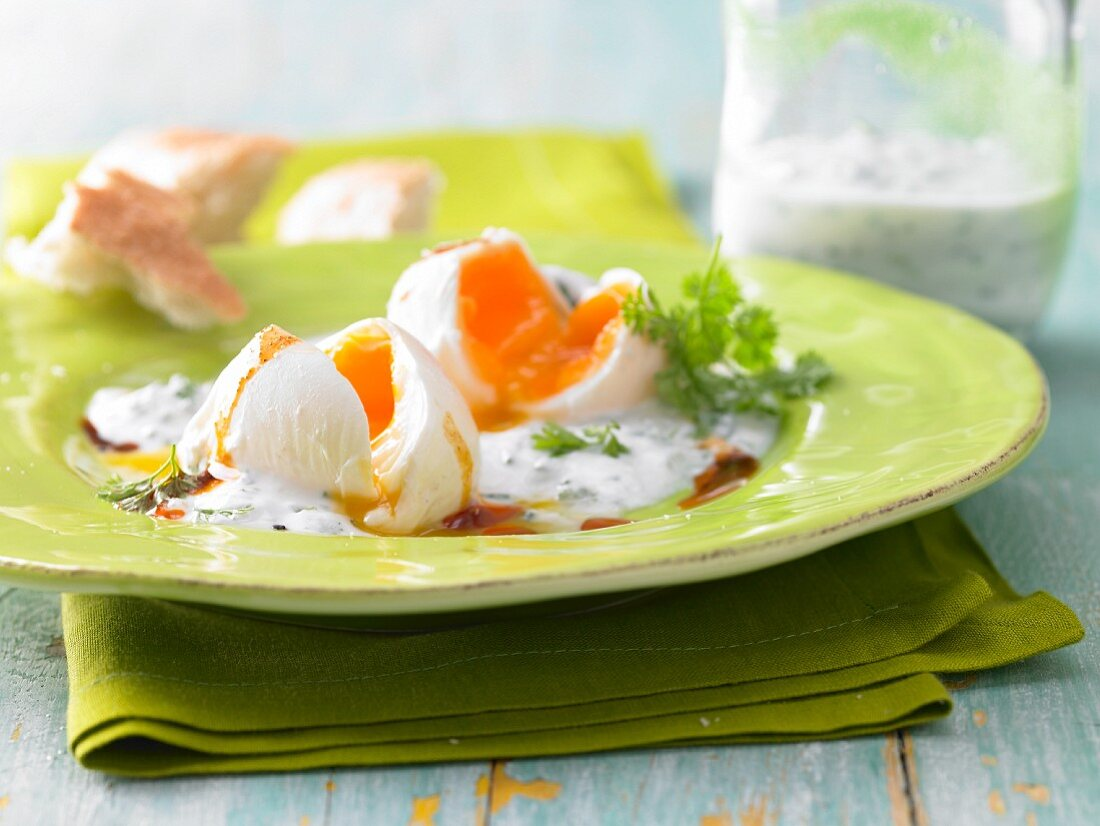 Poached eggs with herb and yoghurt sauce