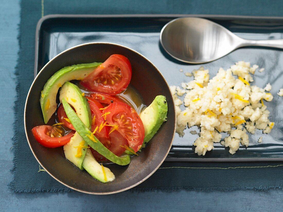 Orange couscous with avocado & tomato salad