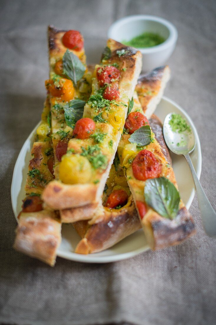 Vegan pizza with caramelised tomatoes and basil salt