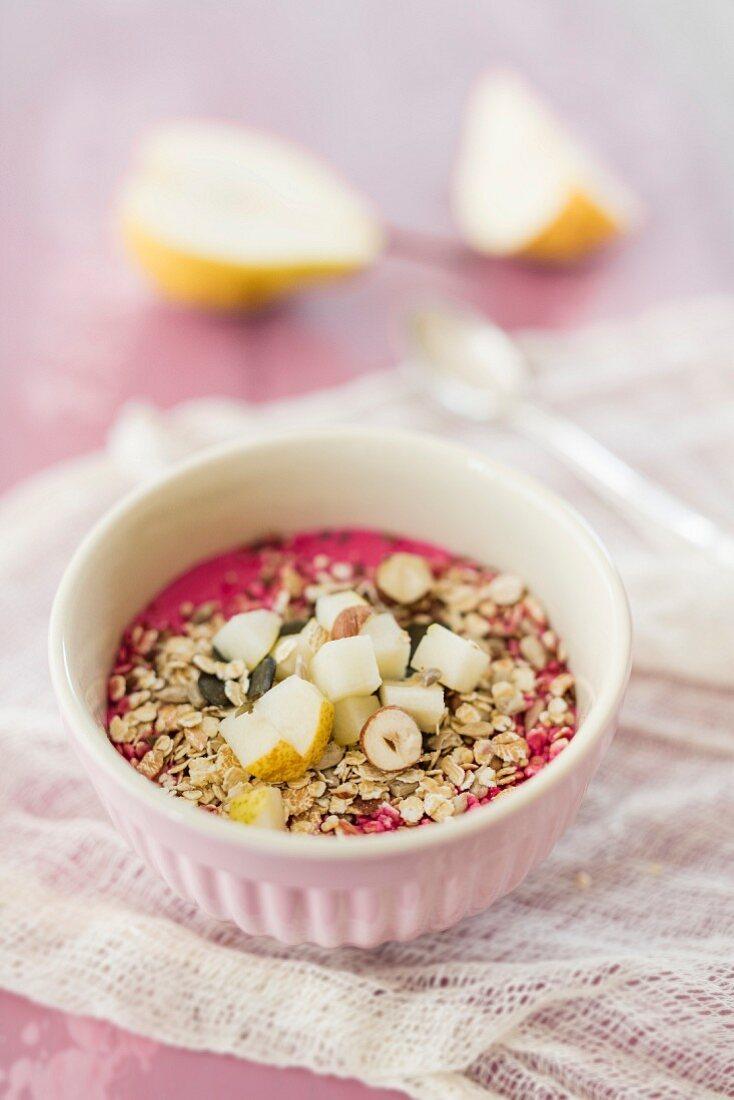 Detox muesli with beetroot, soya yoghurt, pear and nuts