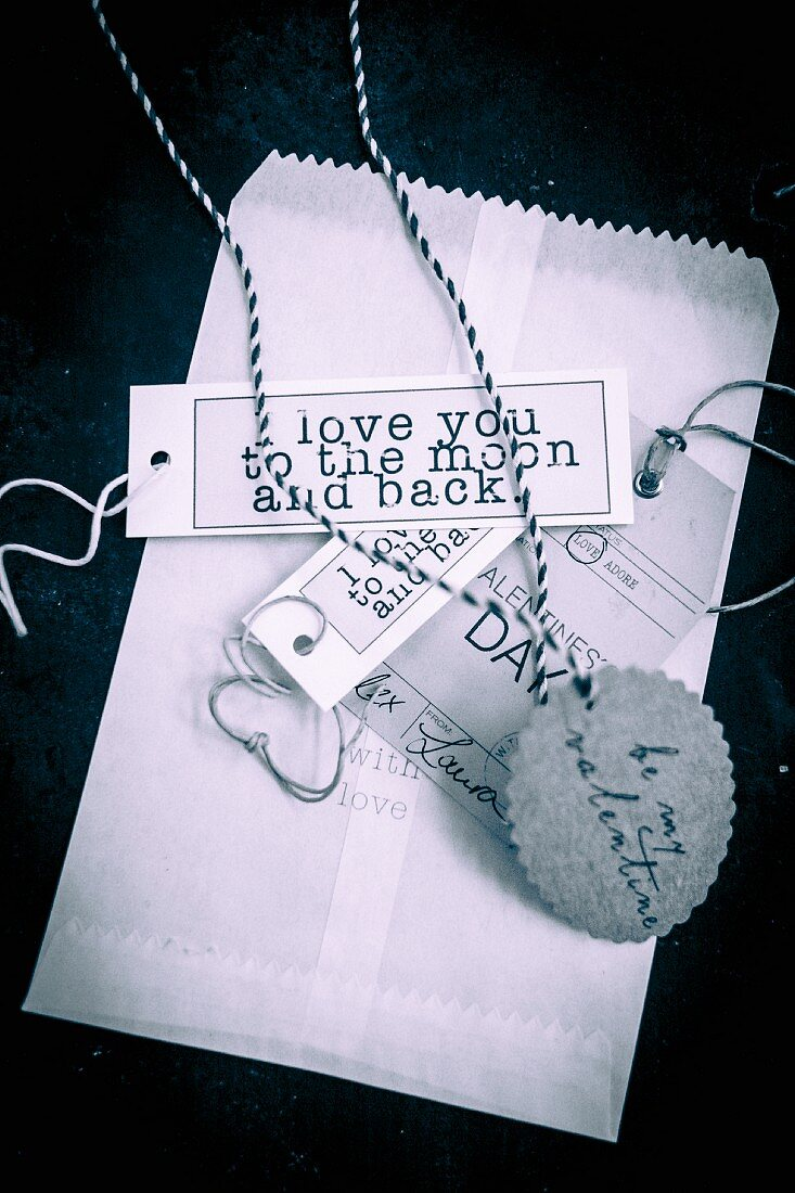 Paper bag and labelled paper tags for St. Valentine's Day