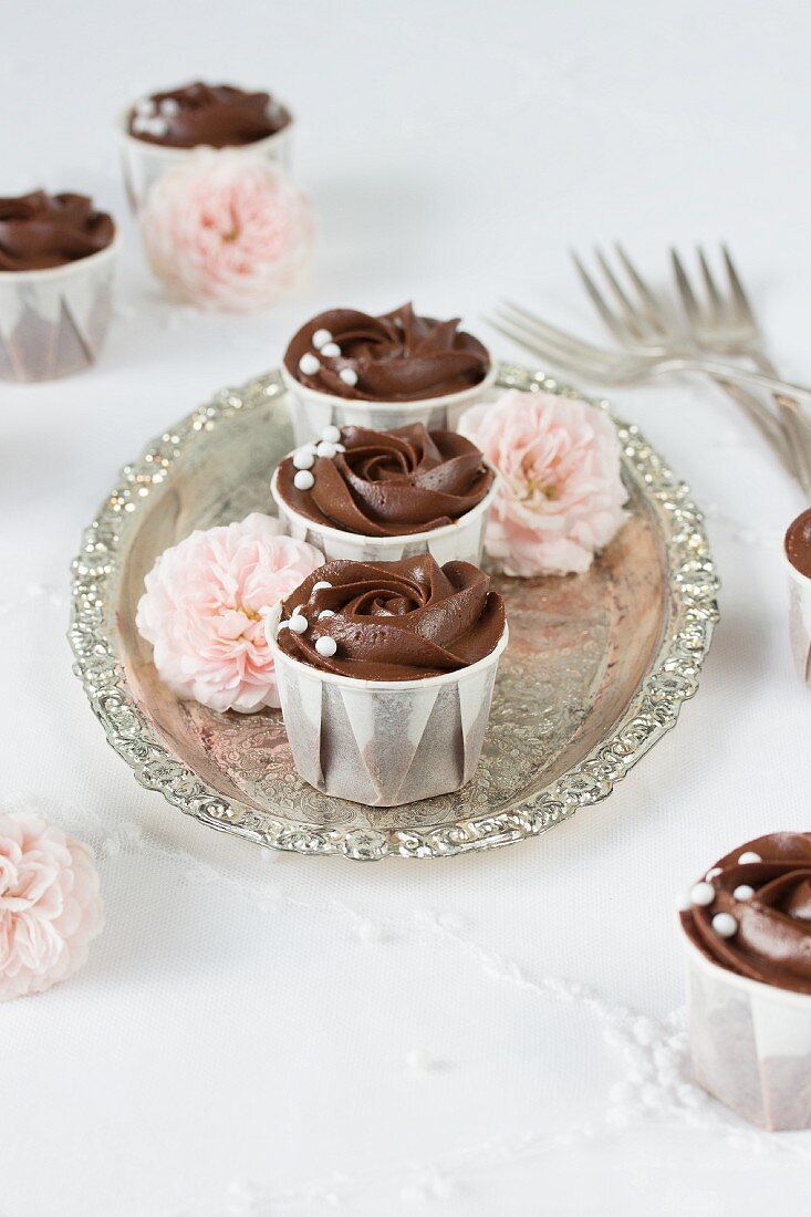 Rose cupcakes on a silver tray