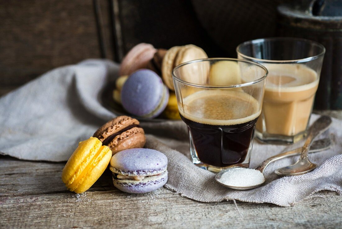 Assorted home-made macarons and glasses of coffee