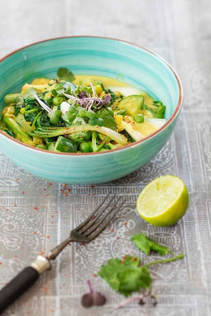 Green vegetable curry in a light blue bowl