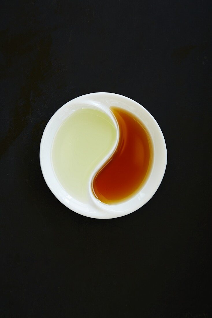 Sesame seed and grapeseed oil in a ying-yang dish