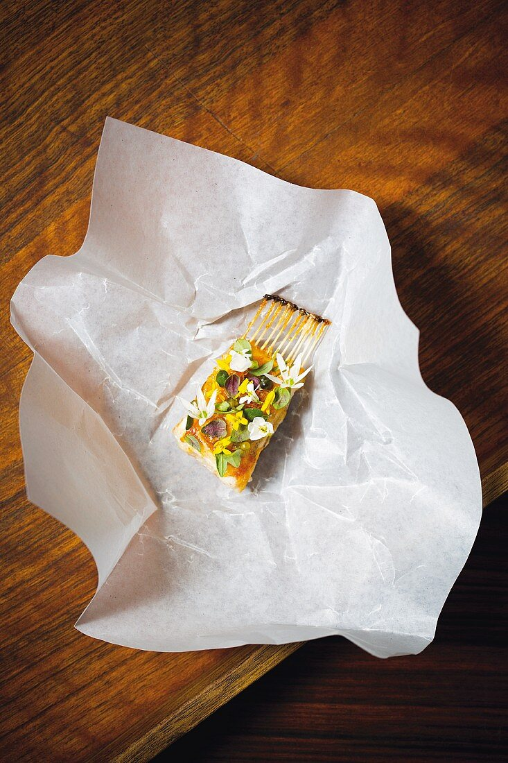 Grilled sole with onion flowers at the restaurant AOC in Copenhagen, Denmark