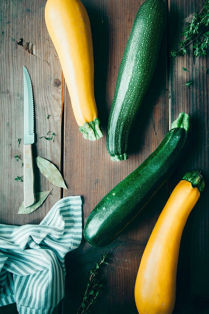 Green and yellow courgette, fresh thyme and bay leaves