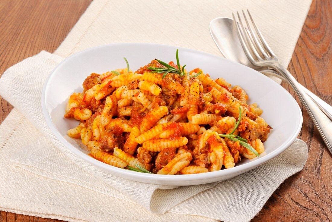 Malloreddus con salsiccia e pomodoro (an Italian pasta dish with sausage and tomatoes)