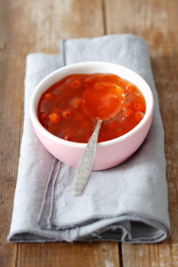 Rowan jam in a bowl with a spoon