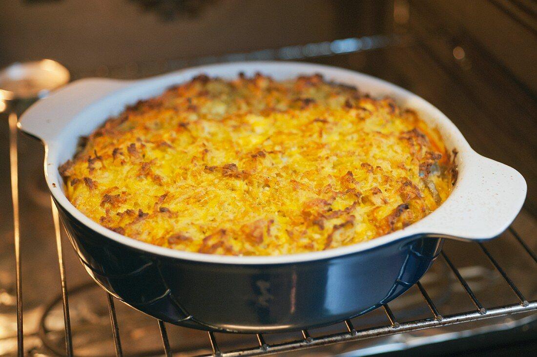 Cardoon & lentil gratin with almonds, pumpkin and potatoes