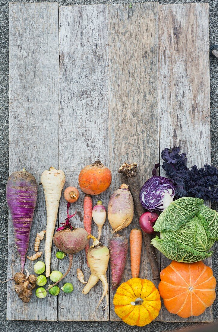Assorted winter vegetables in a wooden board