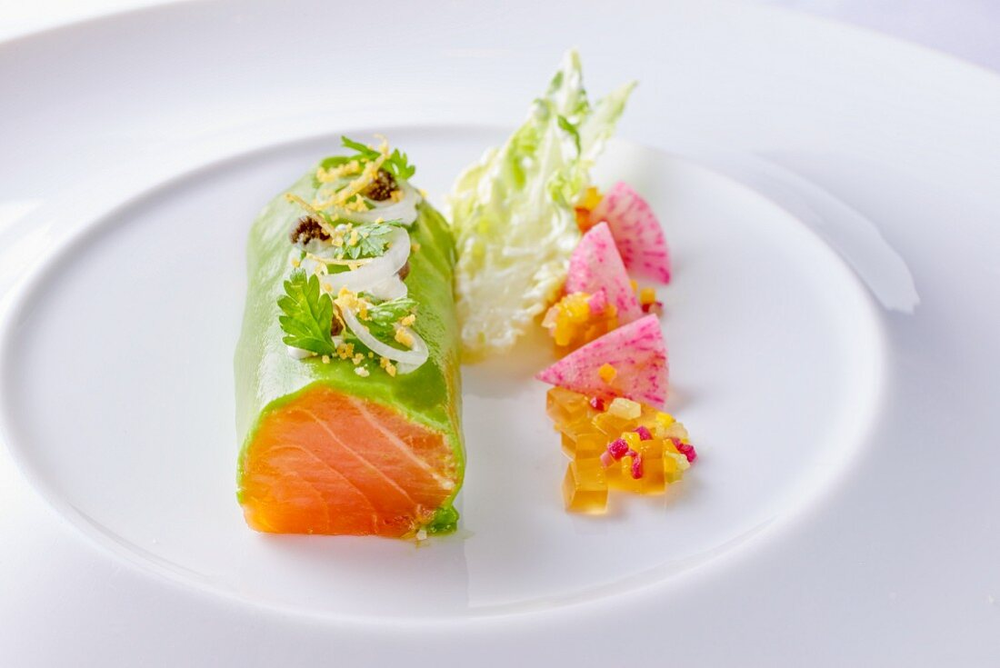 A Norwegian salmon roll with herbs and onion