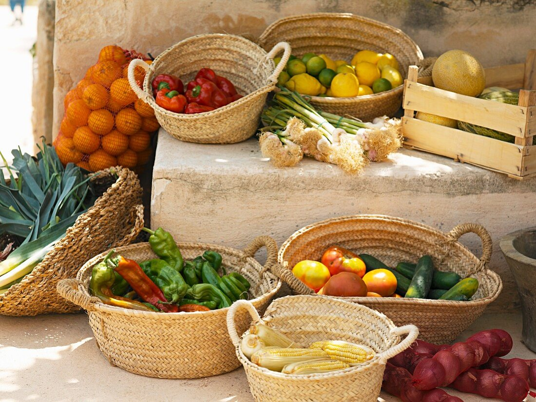 A Mediterranean arrangement of vegetables, citrus fruits and melons