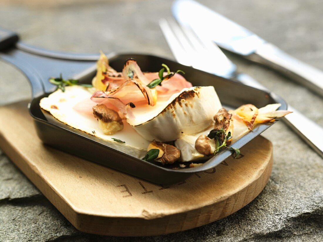 Raclette with ham and walnuts
