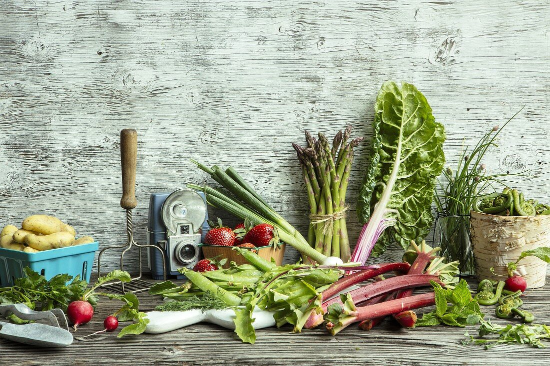An arrangement of spring vegetables and fruit