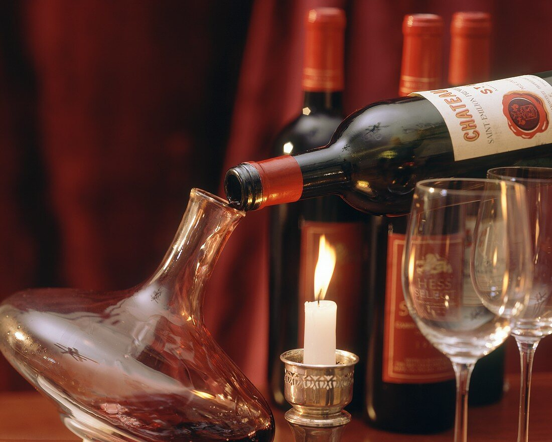 Decanting red wine into stylish decanter