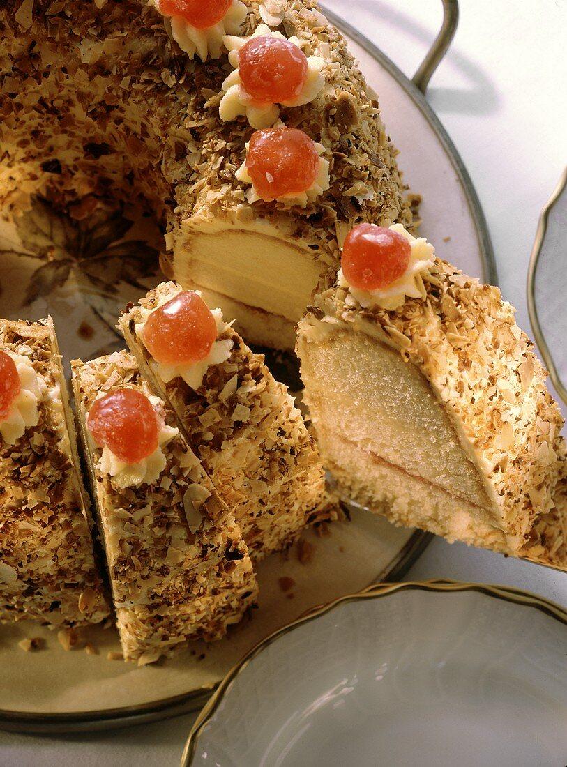 Frankfurt crown cake, pieces cut, on cake plate
