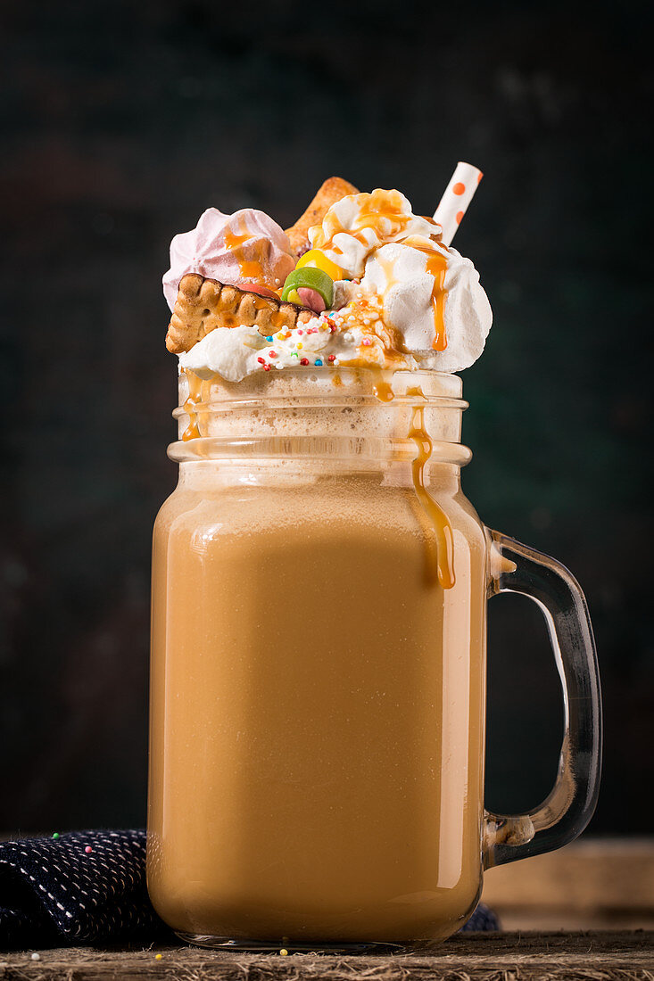 A freak shake with coffee, cream and colourful sweets