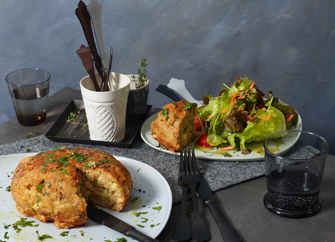 Kaspressknödel (bread and cheese dumplings) with a mixed leaf salad