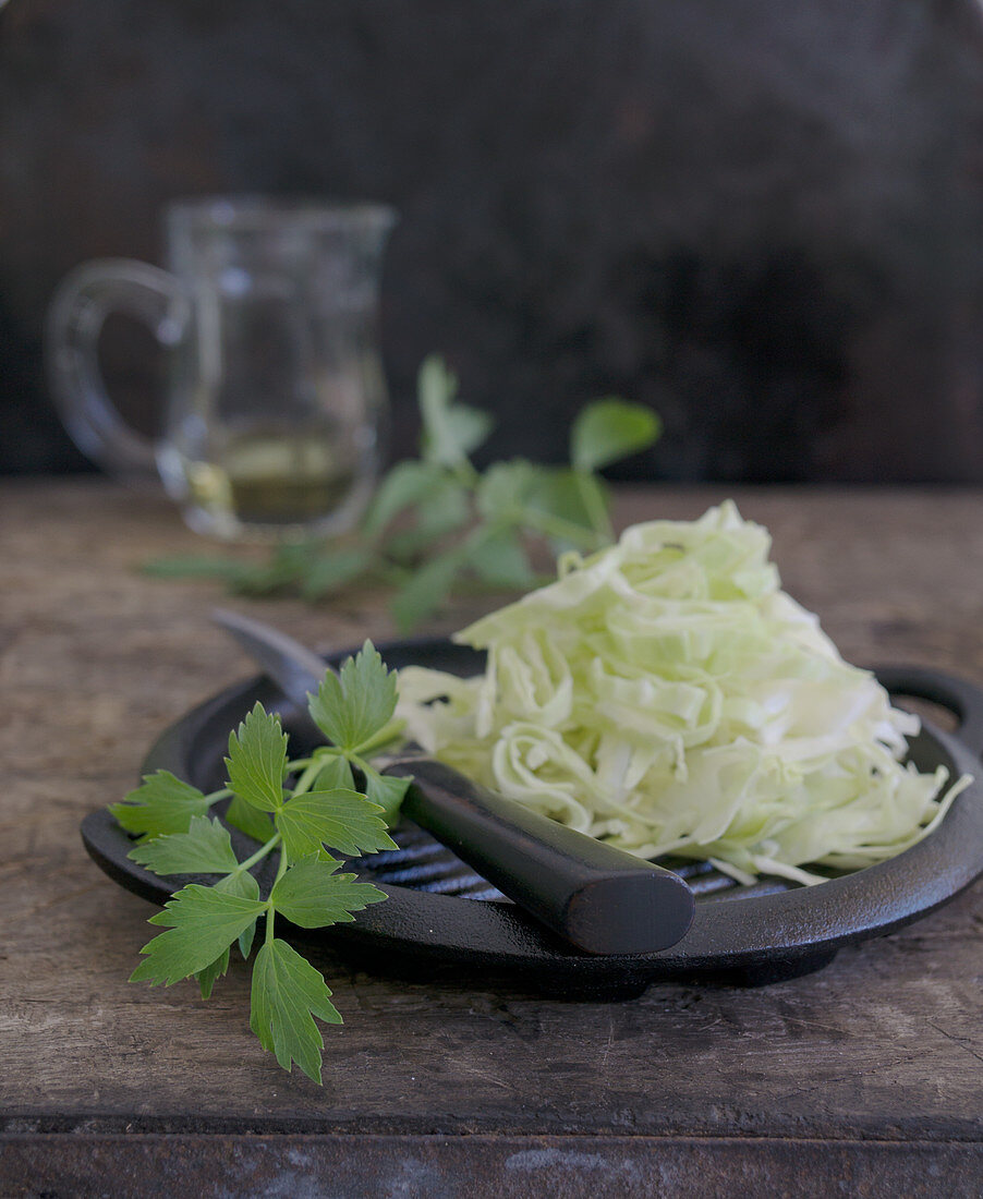 Loveage with pointed cabbage and oil in a jug