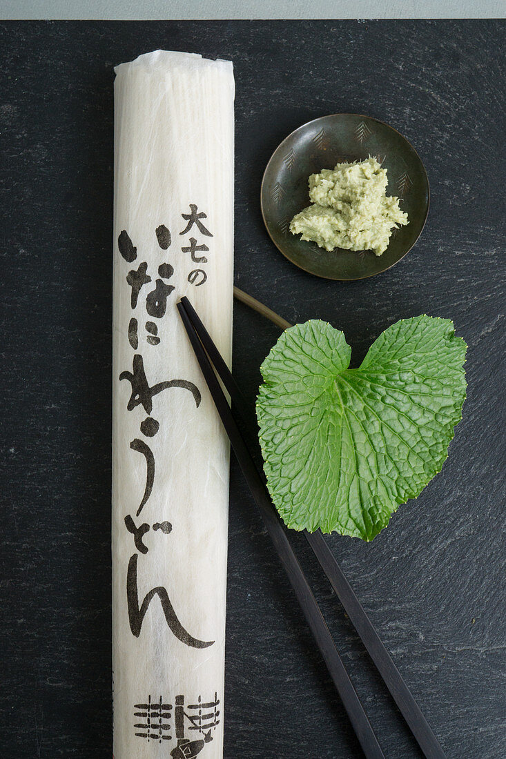 Udon noodles, a wasabi leaf and grated wasabi