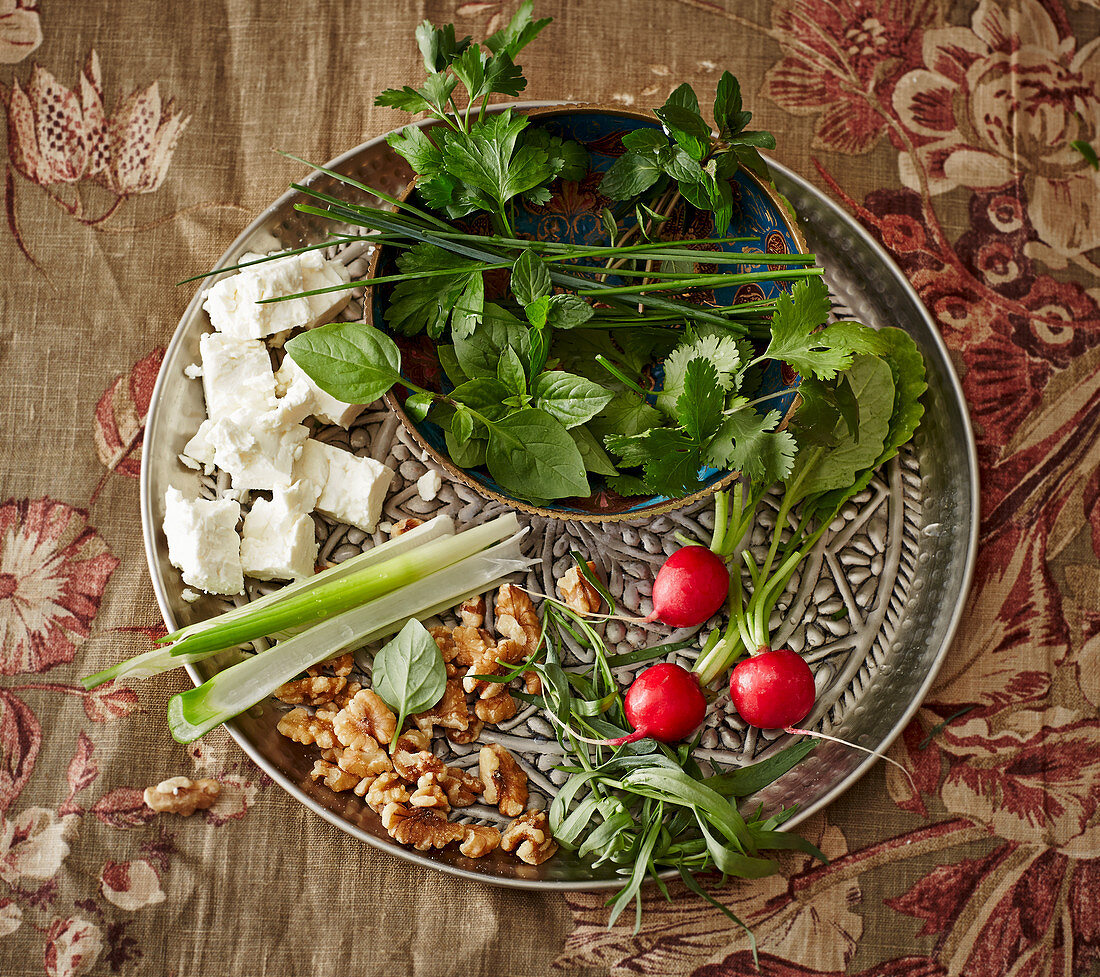 A plate of fresh herbs with feta cheese (Persian appetizer)