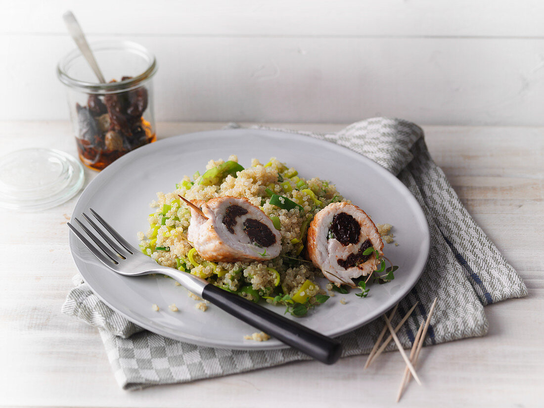 Stuffed turkey roulade on a bed of quinoa and leek