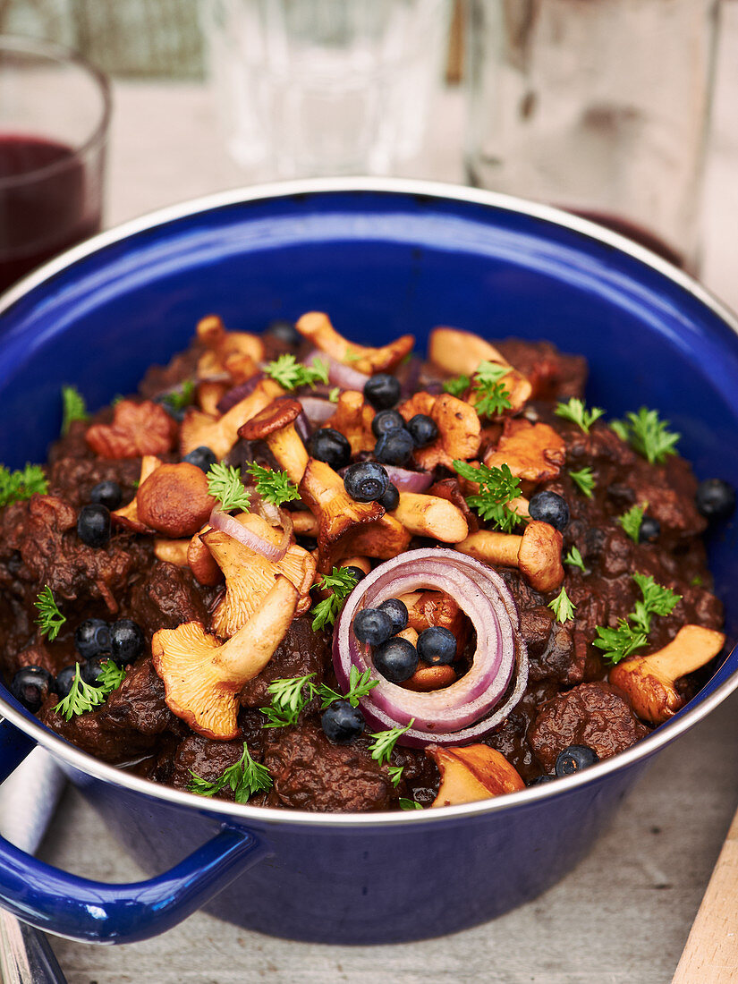 Beef goulash with blueberries and chanterelle mushrooms