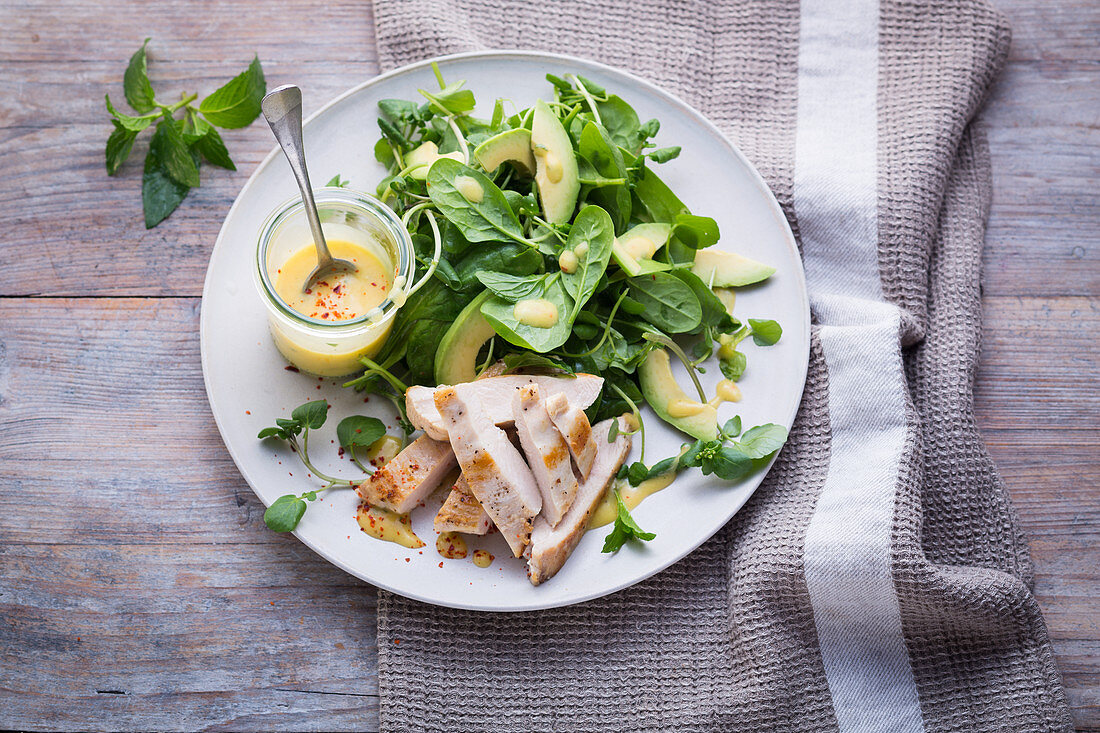 Chicken salad with avocado, watercress and baby leaf spinach