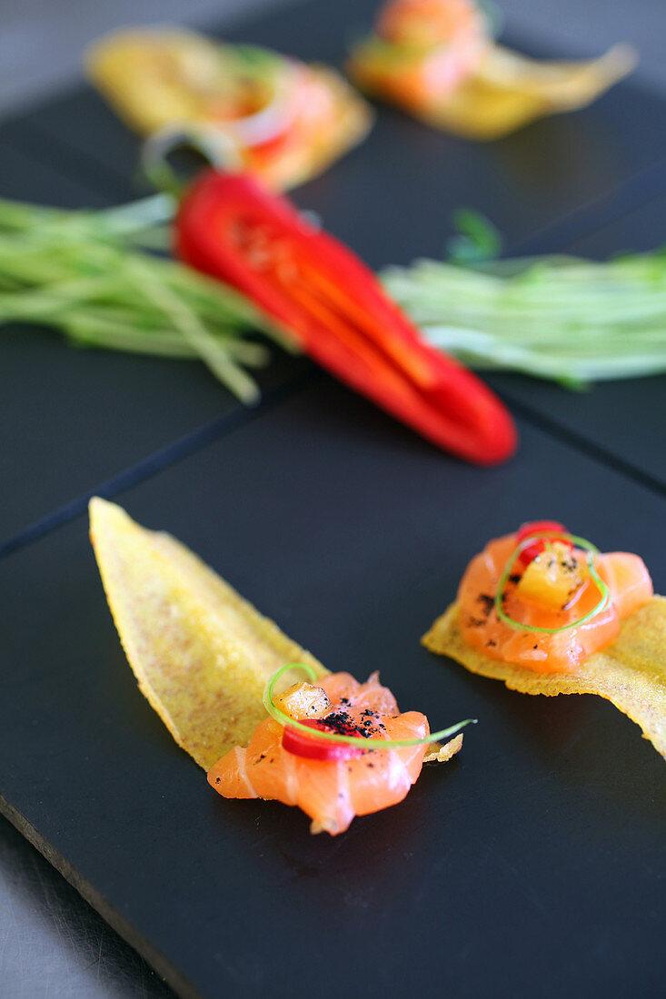 Salmon sashimi on plantain chip