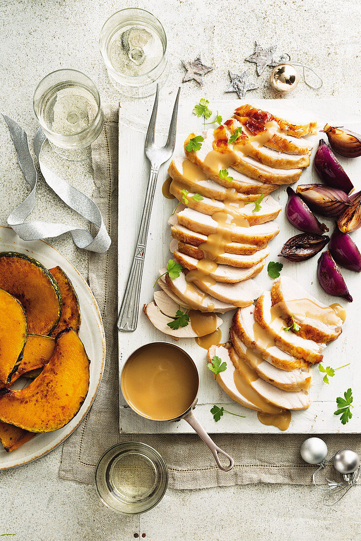 Sliced turkey with rum butter and roasted pumpkin for Christmas
