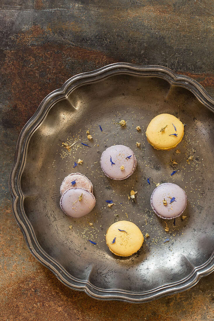Yellow and purple macaroons with cornflower petals