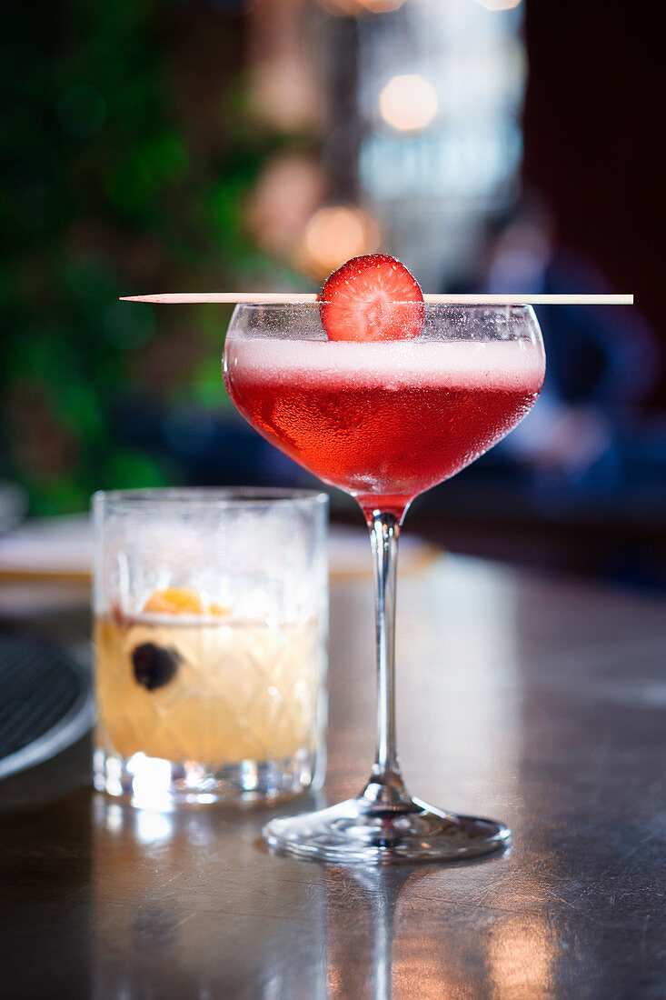 A champagne cocktail with strawberries