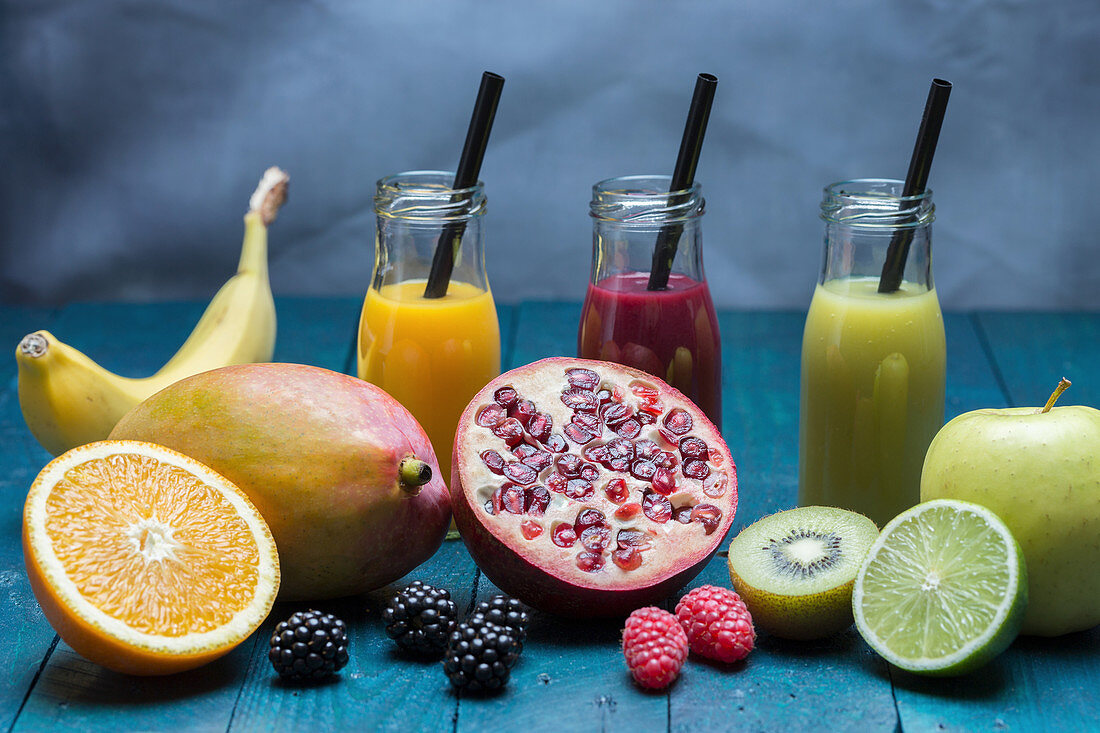 Smoothies: mango and orange, blackberry and pomegranate and kiwi and apple