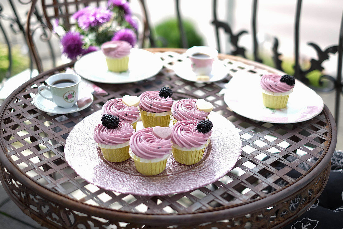 Blackberry cupcakes on a balcony table