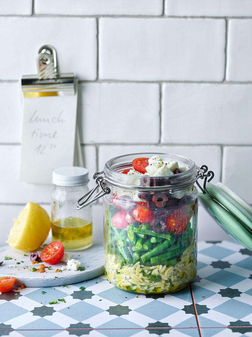Greek kritharaki salad with beans, tomatoes, olives and feta cheese