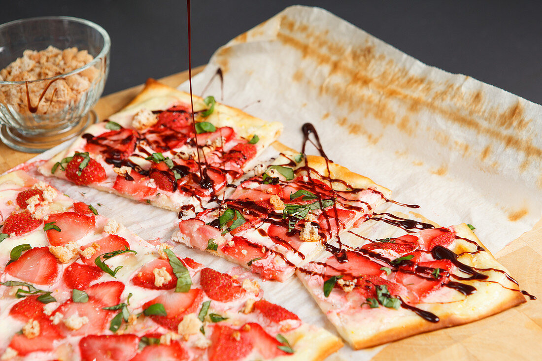 Sweet tarte flambée with strawberries and balsamic vinegar