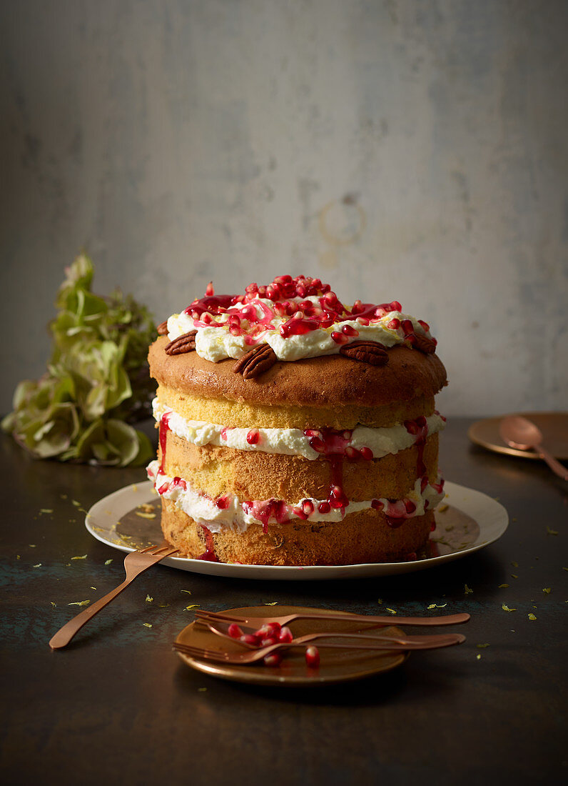 Lemon and mascarpone cake with pecan nuts and pomegranate seeds