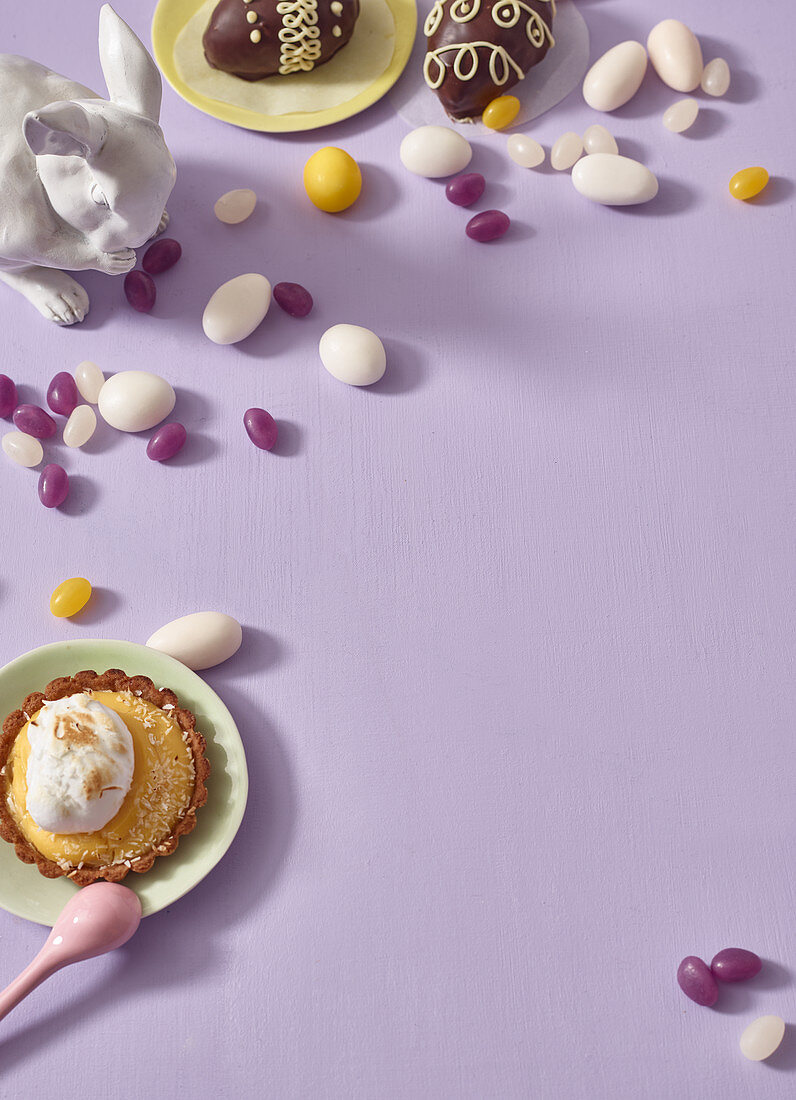 Various Easter sweets and a coconut tartlet