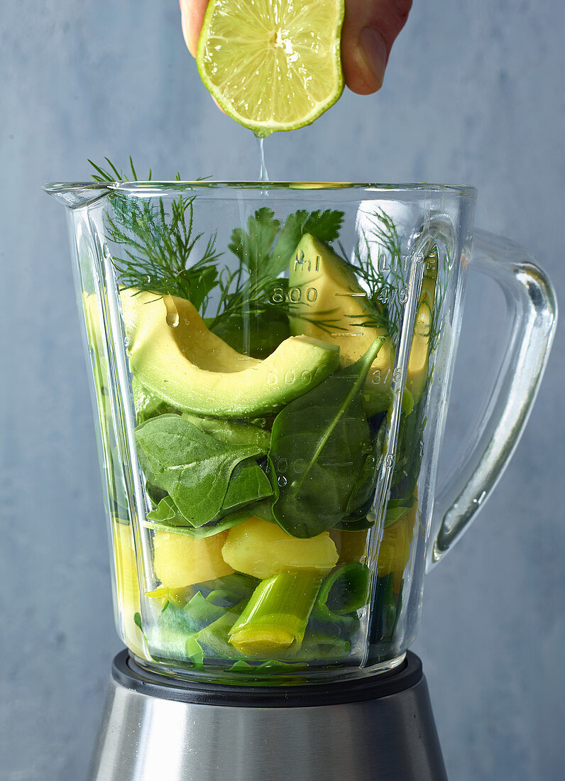 Ingredients for avocado and spinach gazpacho in a blender