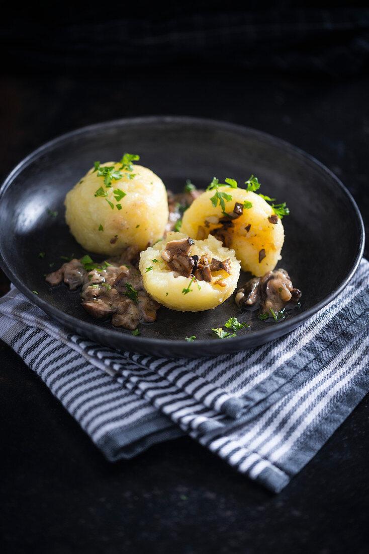 Potato dumplings with a wild mushroom filling (vegan)