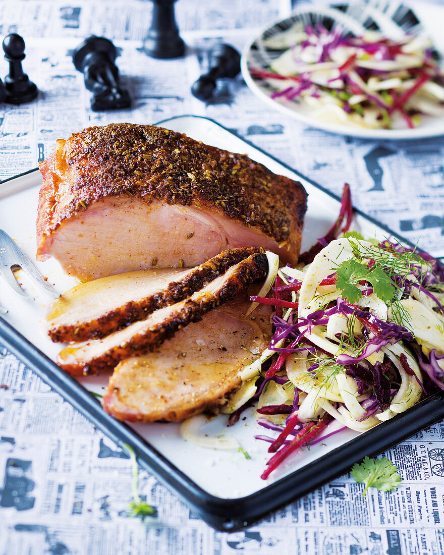 Roasted smoked pork with a fennel and mustard crust served with a fennel and beetroot salad